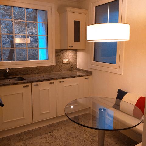 cocina con zona comer banco esquina proyectos diseño interiores reformas decoración
